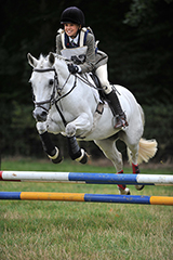 Horse Photographer and Horse Photography of Grey Horse Show Jumping